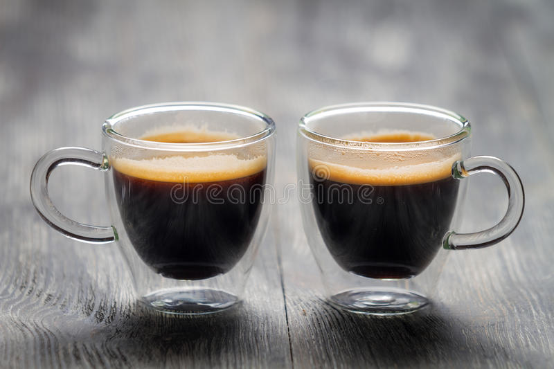 Closeup of two small cups with espresso stock images