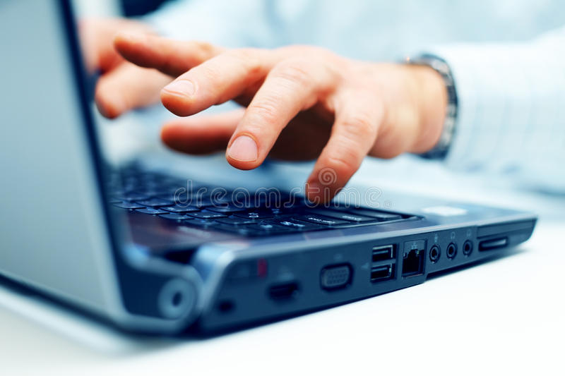 Closeup of typing male hands stock photo