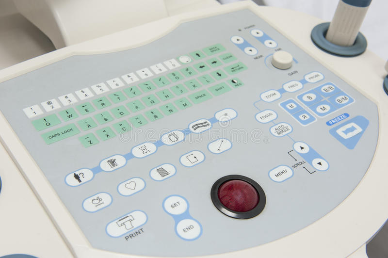 Closeup of an ultrasound scanner machine. Closeup detail of an ultrasound scanner machine control keypad in medical center hospital stock image