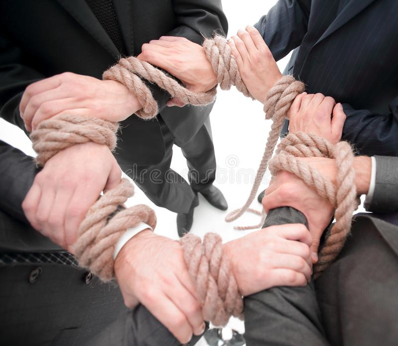 Closeup.unified business team ,tied a strong rope. royalty free stock image