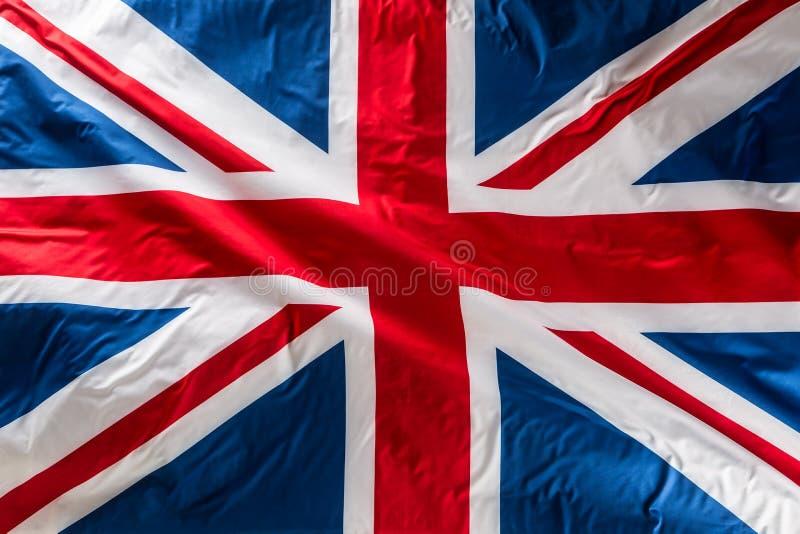 Closeup of Union Jack flag. UK Flag. British Union Jack flag blowing in the wind stock image