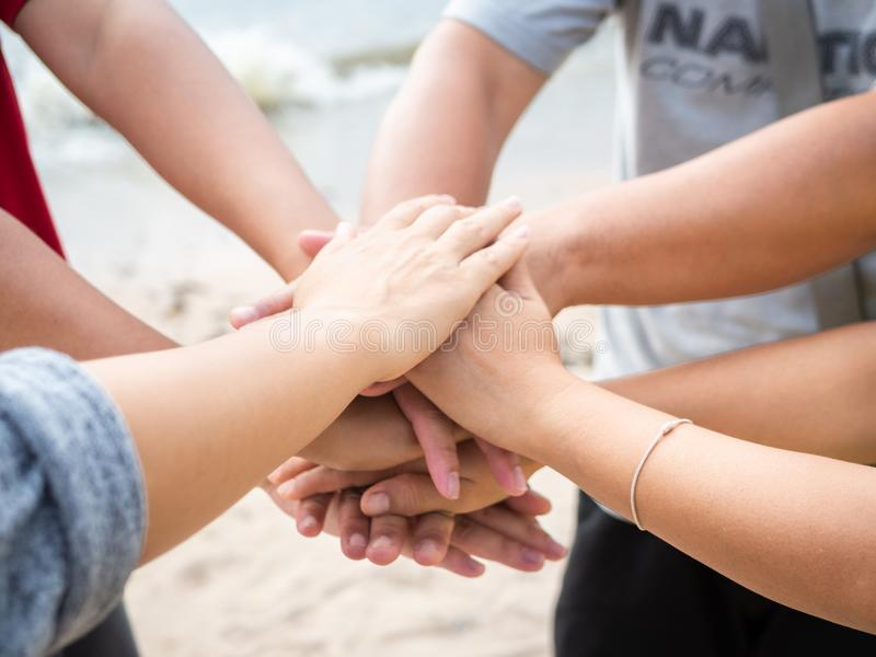 Closeup United hands on the sea background. Friendship, Teamwork stock photos