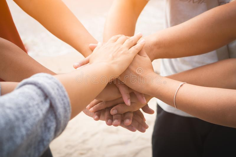 Closeup United hands on the sea background. Friendship, Teamwork stock photo