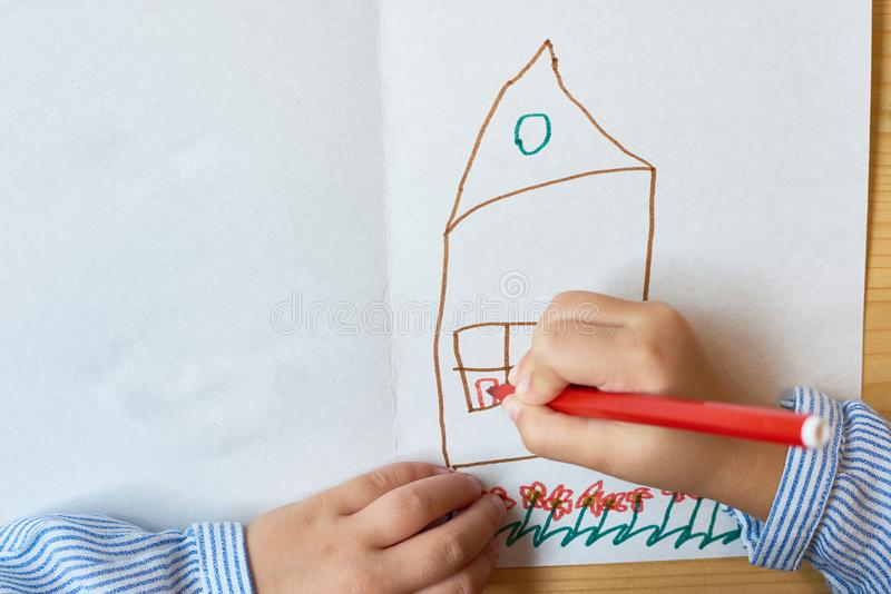 Little Child Drawing House stock image