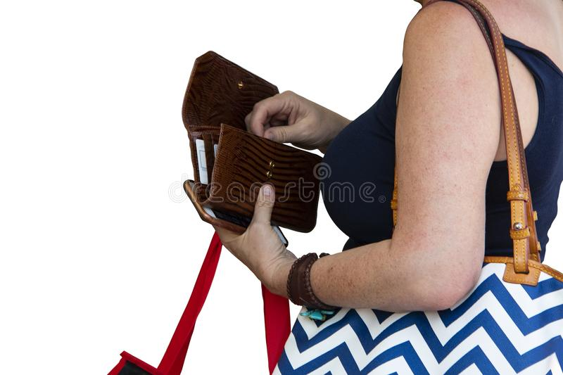 Closeup of unrecognizable woman holding shopping bags opening billfold to get out money for purchase isolated on white room for co. Py stock photography