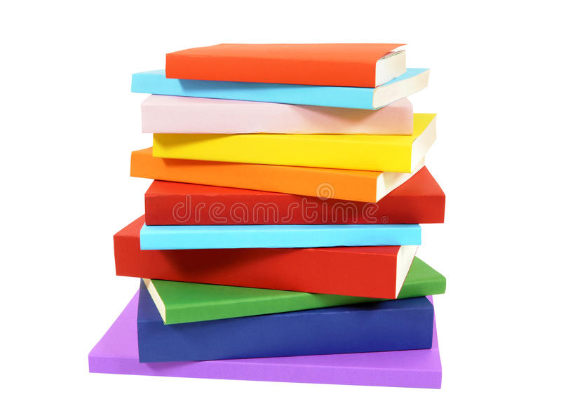 Closeup untidy small pile of books isolated on white background royalty free stock photo