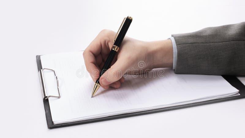 closeup Uomo d'affari che firma un contratto Foto con lo spazio della copia fotografie stock