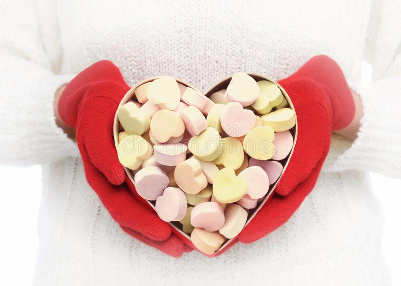 Closeup of a Woman Holding a Heart Shaped Valentines Day box filled with Candy Hearts stock images