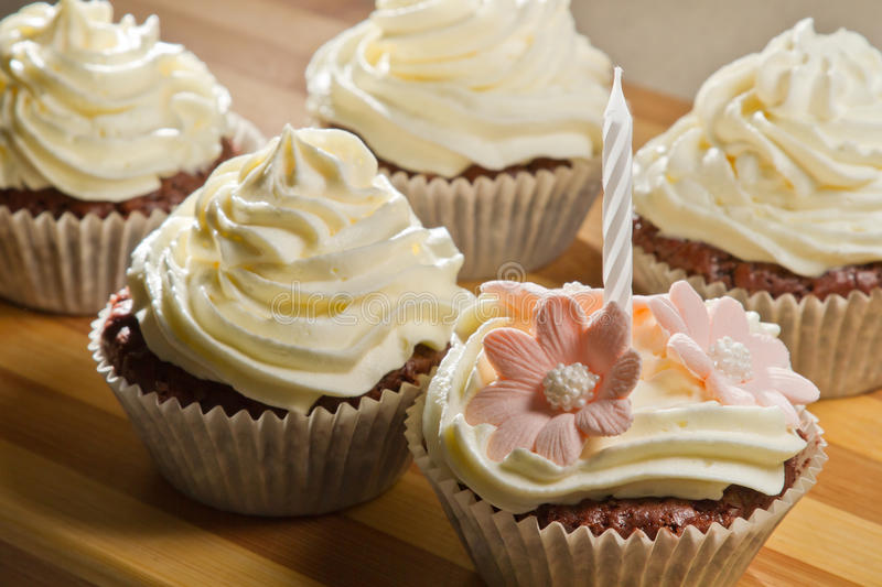 Closeup vanilla muffin with small candle royalty free stock image