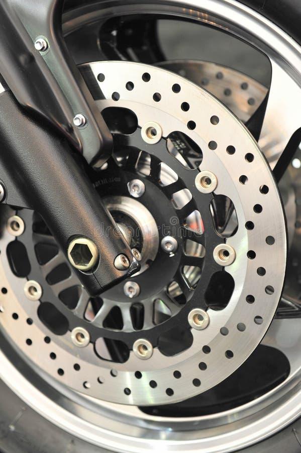 Ventilated bike brake disc. Closeup on a ventilated brake disc stock image
