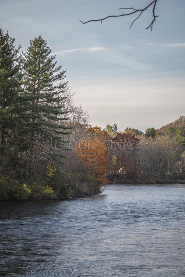 A Closeup Vertical Autumn View during Sunset of the West Canada Creek Meander at Barneveld, New York. Mud, cincinnati, state, upstate, ny, trenton, river stock photo
