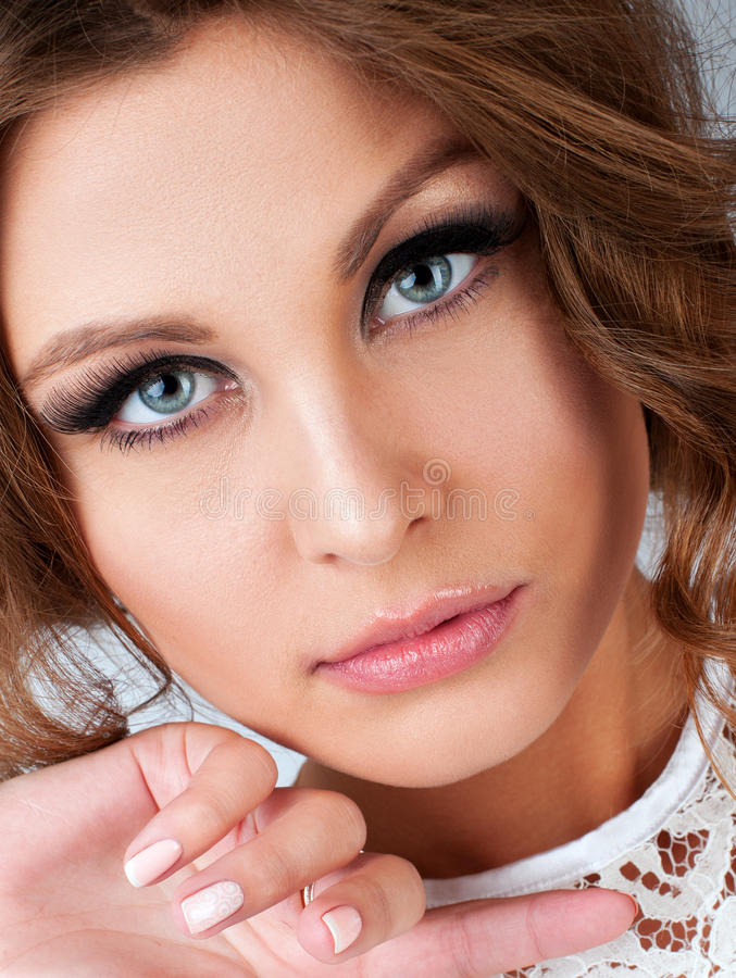 Closeup vertical portrait of beautiful woman with look and royalty free stock photography