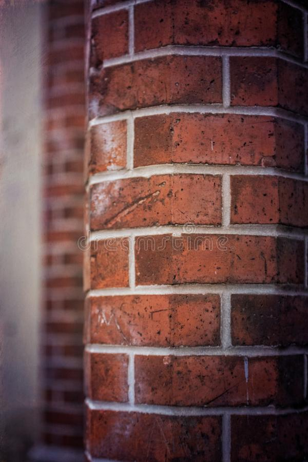 Closeup vertical shot of a red brick round wall. A closeup vertical shot of a red brick round wall stock photography