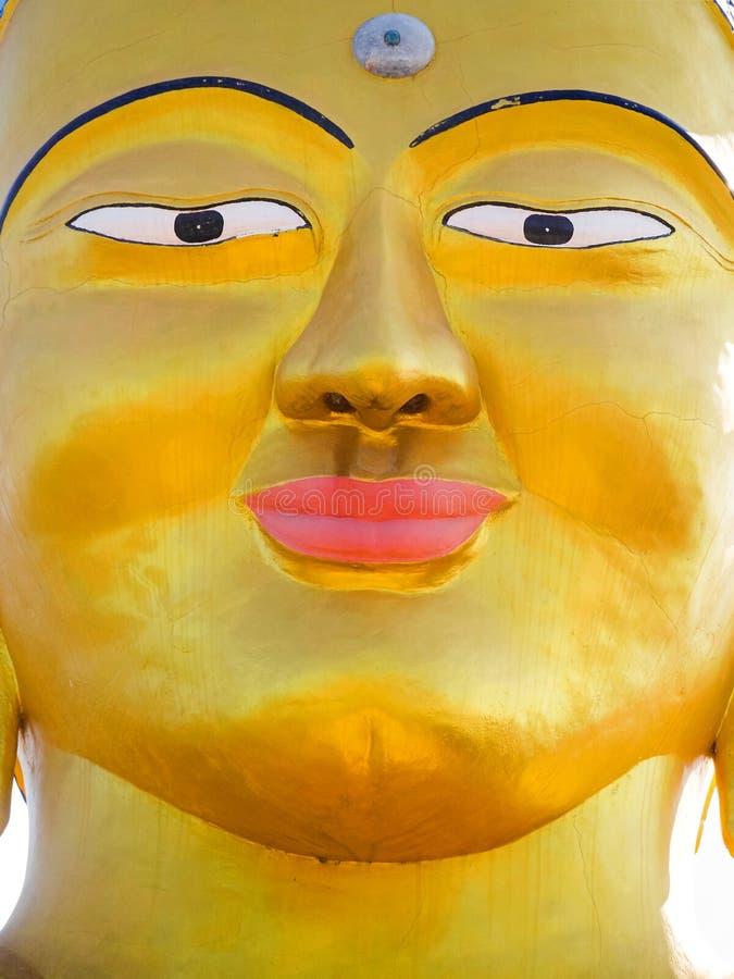 Closeup vibrant gold Shanti Ban Buddha face, golden Buddha`s image in Dhulikhel, Nepal stock image