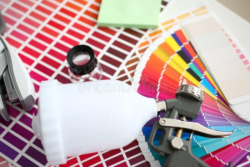 Closeup view of airbrush gun at colour check royalty free stock images