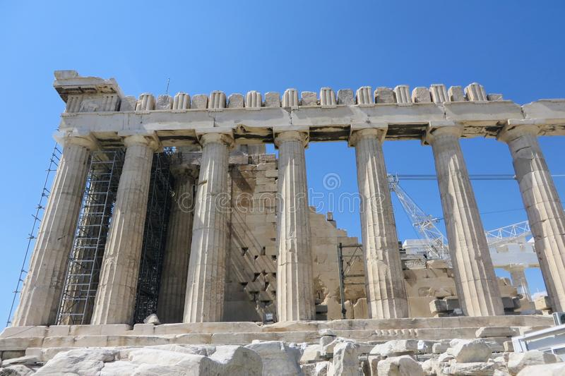 A closeup view of the ancient wonder the Parthenon atop the Acropolis, in Athens, Greece.  The temple is undergoing construction stock photography