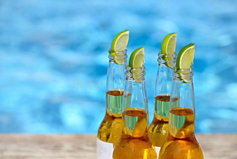 Closeup view of beer bottles and lime slices royalty free stock photos