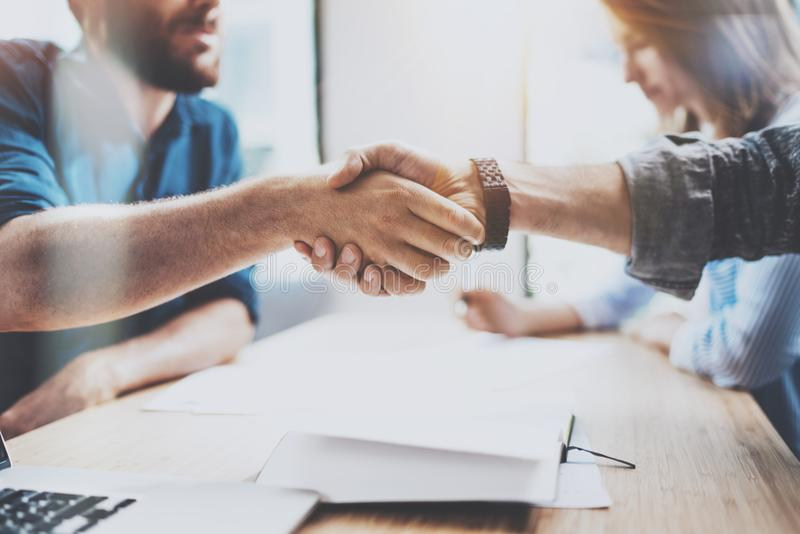 Closeup view of Business male partnership handshake. Photo two coworkers handshaking process. Successful deal after great stock photography