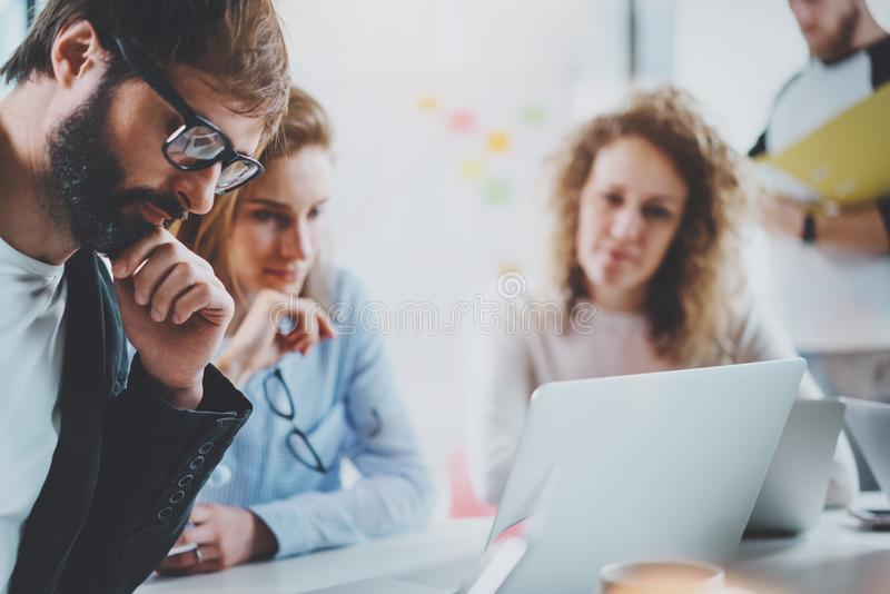 Closeup view Business team making conversation at sunny meeting room.Horizontal.Blurred background. royalty free stock photos