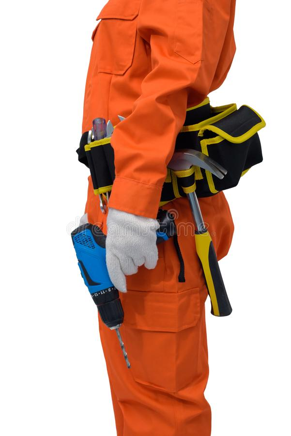 Construction workers wearing Orange Protective clothes, helmet hand holding electric drill with tool belt isolated on white. Closeup view of construction woman stock images