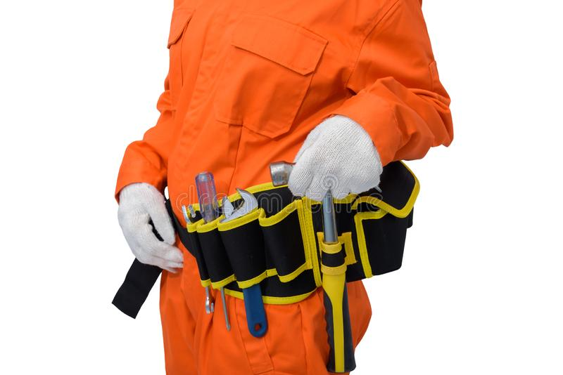 Construction workers wearing Orange Protective clothes, helmet hand holding hammer with tool belt isolated on white backround. Closeup view of construction woman royalty free stock photos