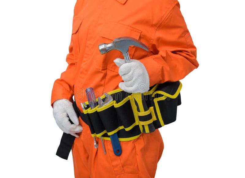 Construction workers wearing Orange Protective clothes, helmet hand holding hammer with tool belt isolated on white backround. Closeup view of construction woman royalty free stock photo