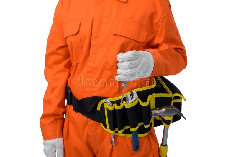 Construction workers wearing Orange Protective clothes, helmet hand holding screwdriver with tool belt isolated on white backround. Closeup view of construction stock photography