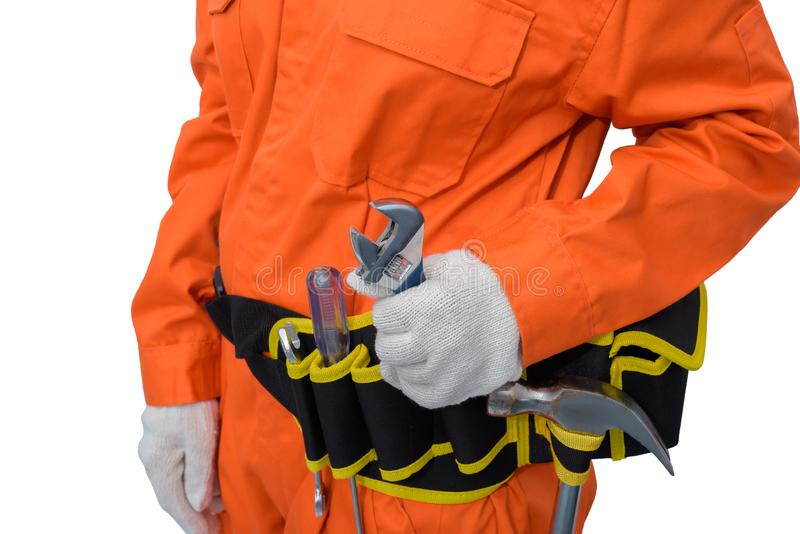 Construction workers wearing Orange Protective clothes, helmet hand holding wrench with tool belt isolated on white backround. Closeup view of construction woman royalty free stock image