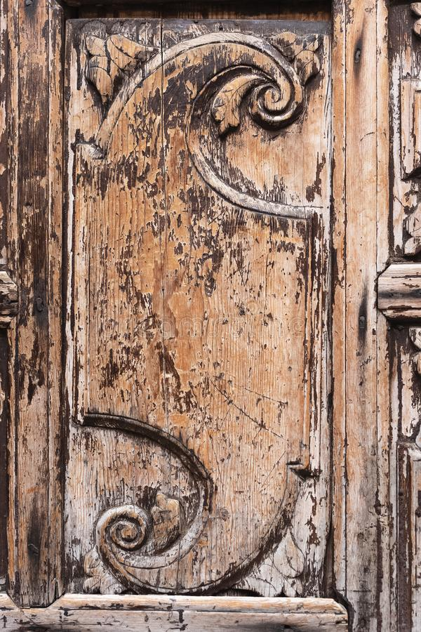 Closeup view of decorative element on old vintage wooden door stock photo