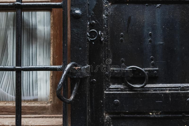 Closeup view of details of old black door. royalty free stock photo