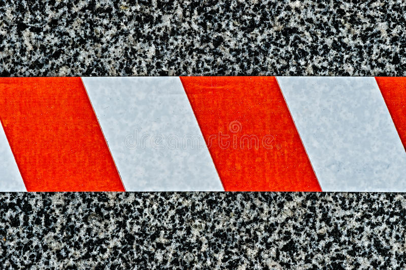 Closeup view of the do not cross warning tape stock image