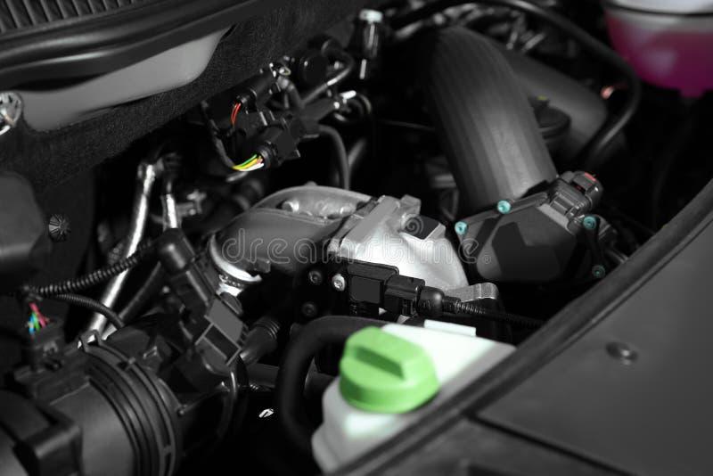 Closeup view of engine bay in car. Closeup view of engine bay in modern car stock photo