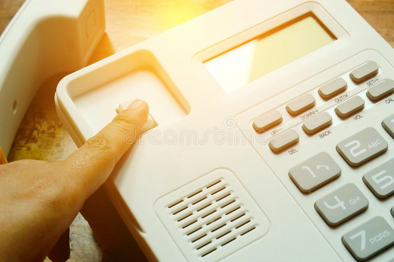 Closeup view of finger press reject or cancel call button on landline telephone. Closeup view of finger press reject or cancel call button on landline telephone stock image