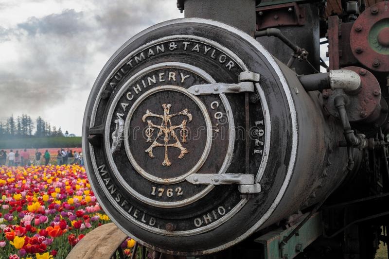 Up close view of a front part of a steam engine with engraving on it royalty free stock images