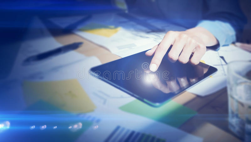 Closeup view of girl touching the screen of digital tablet with your finger.Concept business people working with mobile stock photography