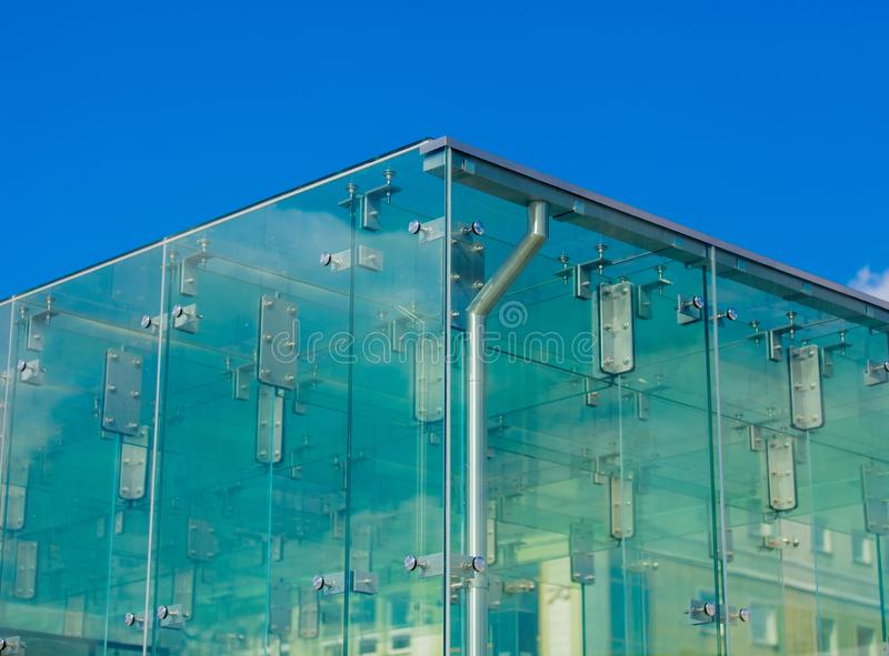Closeup view on glass wall corner of a building royalty free stock photos