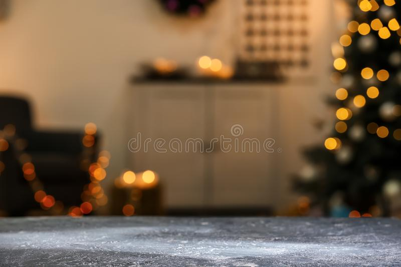Closeup view of grey table against blurred Christmas interior stock images