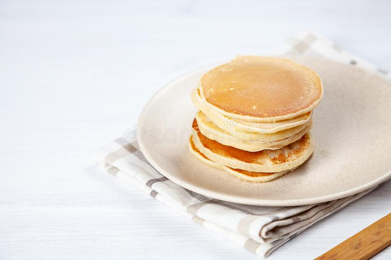 Closeup view on on homemade classic stack of american pancake on white background with morning light. Breakfast food. selective royalty free stock photo