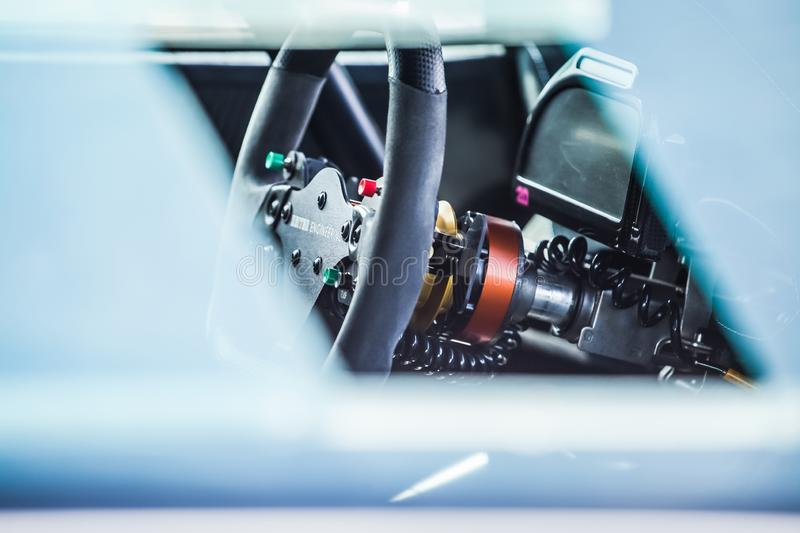 Closeup view of inside of a supercar. Steering wheel controls.  royalty free stock image