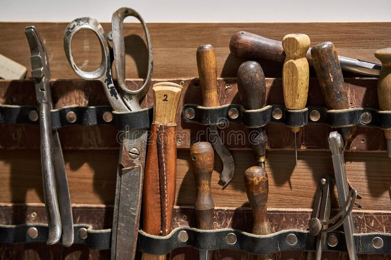 Closeup view at instruments for leather sewing stock photo