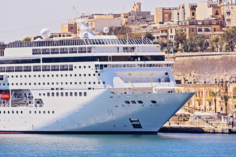 Closeup view of large cruise liner ship in Valletta Grand harbor in Malta with in sea bay royalty free stock photo