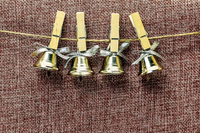 Closeup view of many beautiful old fashioned golden christmas bells hanging as new year toys, horizontal picture stock photography