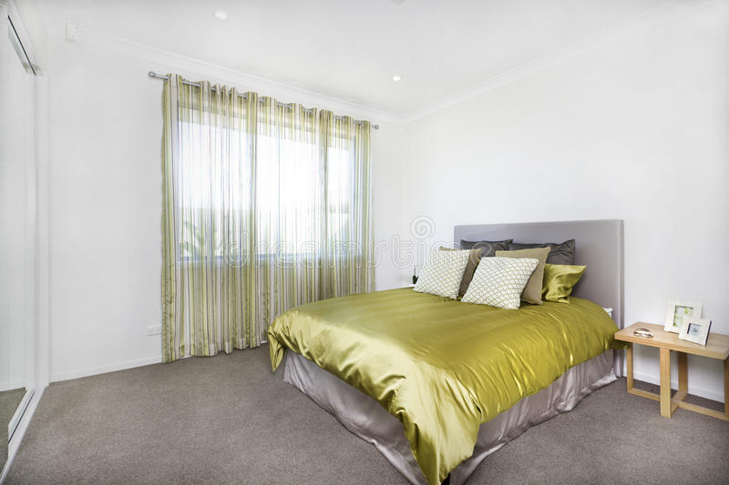 Closeup view of the modern bedroom interior with an entrance stock photography