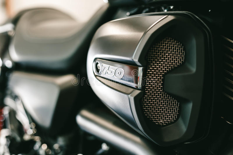 Closeup view of part of sporty black motorcycle royalty free stock photography