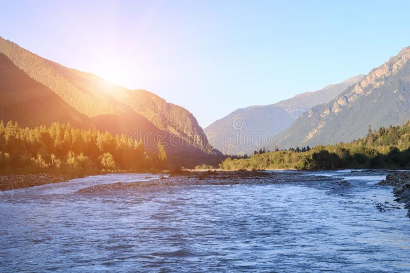 Closeup view river scenes in mountains of national park Dombai, Caucasus, Russia. Europe. Summer landscape, sunshine weather, dramatic blue sky and sunny day stock photography
