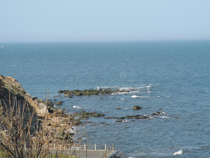 Closeup view of the rocks while the tide is coming in near Tynemouth royalty free stock photography