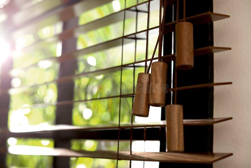 Sunlit horizontal window blinds. Closeup view of sunlit horizontal window blinds royalty free stock photo