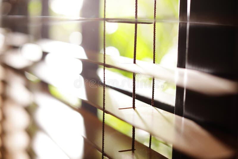 Sunlit horizontal window blinds. Closeup view of sunlit horizontal window blinds royalty free stock photos