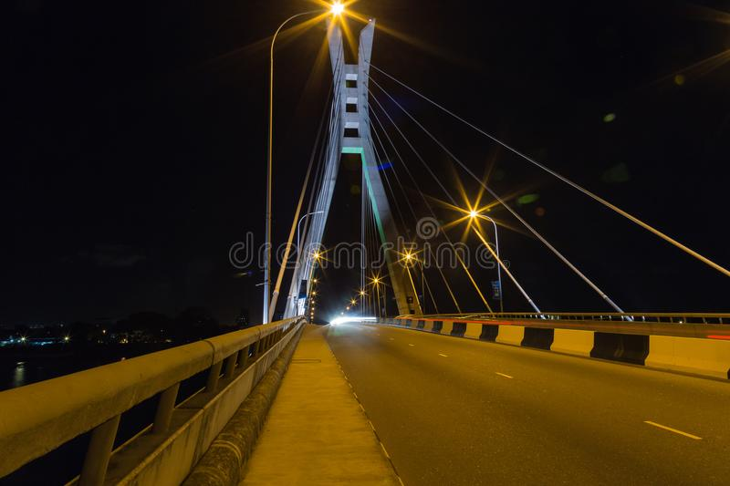 Closeup view of suspension tower and cables of Ikoyi bridge Lagos Nigeria. Lagos is the coastal commercial capital of Nigeria and has a vibrant night life. One stock images