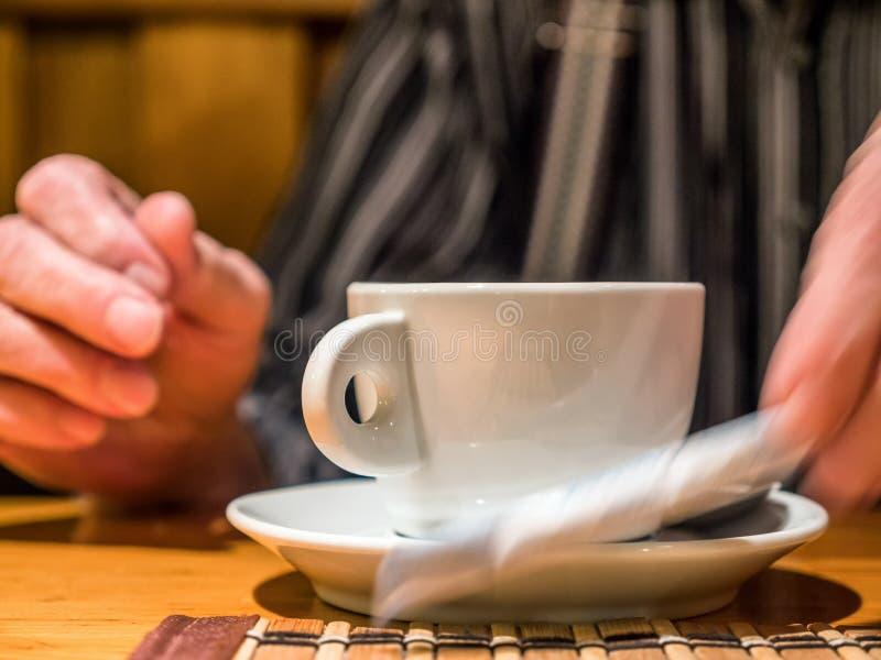 Closeup view tea cup in senior hand stock image